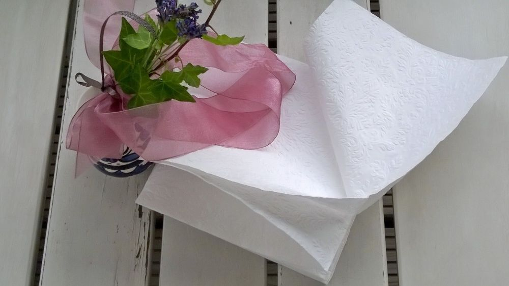 Some wind lifts the napkins gently